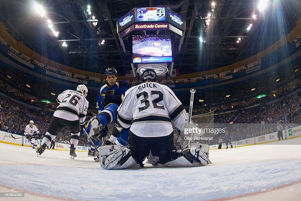 <a gi-track='captionPersonalityLinkClicked' href=/galleries/search?phrase=Jonathan+Quick&family=editorial&specificpeople=2271852 ng-click='$event.stopPropagation()'>Jonathan Quick</a> #32 of the Los Angeles Kings makes a save against <a gi-track='captionPersonalityLinkClicked' href=/galleries/search?phrase=Ryan+Reaves&family=editorial&specificpeople=4601052 ng-click='$event.stopPropagation()'>Ryan Reaves</a> #75 of the St. Louis Blues in Game One of the Western Conference Quarterfinals during the 2013 NHL Stanley Cup Playoffs at the Scottrade Center on April 30, 2013 in St. Louis, Missouri. The Blues beat the Kings 2-1 in overtime.