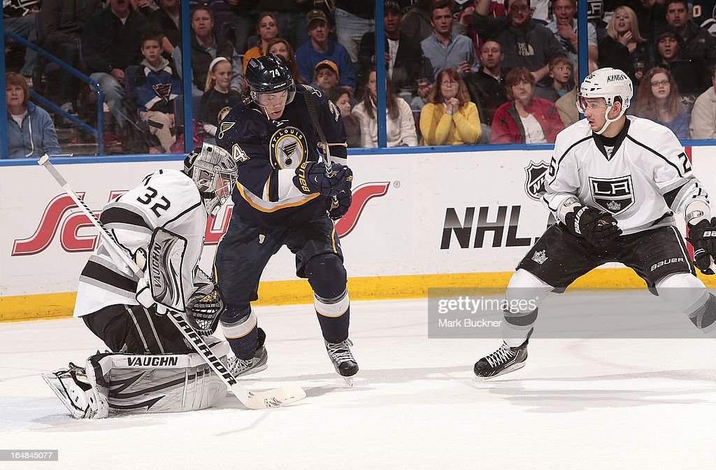 <a gi-track='captionPersonalityLinkClicked' href=/galleries/search?phrase=Jonathan+Quick&family=editorial&specificpeople=2271852 ng-click='$event.stopPropagation()'>Jonathan Quick</a> #32 of the Los Angeles Kings makes a save as <a gi-track='captionPersonalityLinkClicked' href=/galleries/search?phrase=T.J.+Oshie&family=editorial&specificpeople=700383 ng-click='$event.stopPropagation()'>T.J. Oshie</a> #74 of the St. Louis Blues looks for the rebound in an NHL game on March 28, 2013 at Scottrade Center in St. Louis, Missouri.