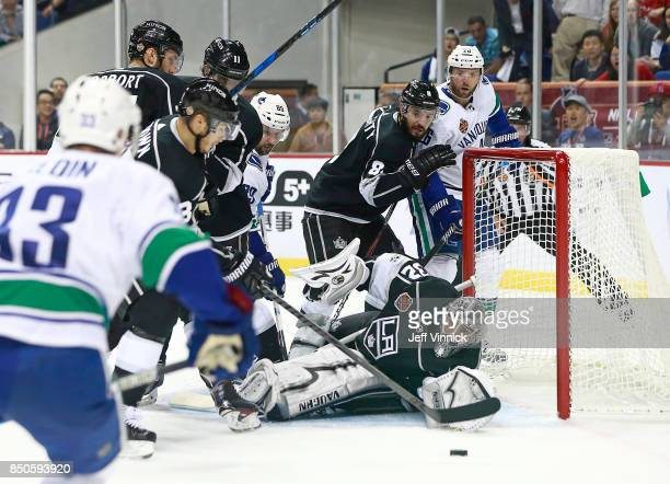 Jonathan Quick of the Los Angeles Kings makes a save off a Vancouver Canucks shot during their preseason game at the MercedesBenz Arena September 21...