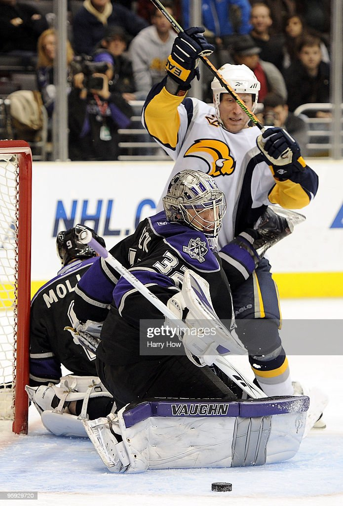 <a gi-track='captionPersonalityLinkClicked' href=/galleries/search?phrase=Jonathan+Quick&family=editorial&specificpeople=2271852 ng-click='$event.stopPropagation()'>Jonathan Quick</a> #32 of the Los Angeles Kings makes a save on <a gi-track='captionPersonalityLinkClicked' href=/galleries/search?phrase=Adam+Mair&family=editorial&specificpeople=206324 ng-click='$event.stopPropagation()'>Adam Mair</a> #22 of the Buffalo Sabres on way to a 4-3 in the overtime shootout period at the Staples Center on January 21, 2010 in Los Angeles, California.