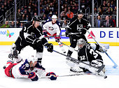 Jonathan Quick of the Los Angeles Kings makes a save on Brandon Dubinsky of the Columbus Blue Jackets as Brayden McNabb reaches to clear the rebound...