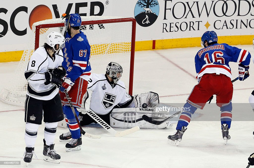 Jonathan Quick #32 of the Los Angeles Kings makes a save on Derick Brassard #16 of the New York Rangers during the first period of Game Four of the 2014 NHL Stanley Cup Final at Madison Square Garden on June 11, 2014 in New York, New York.