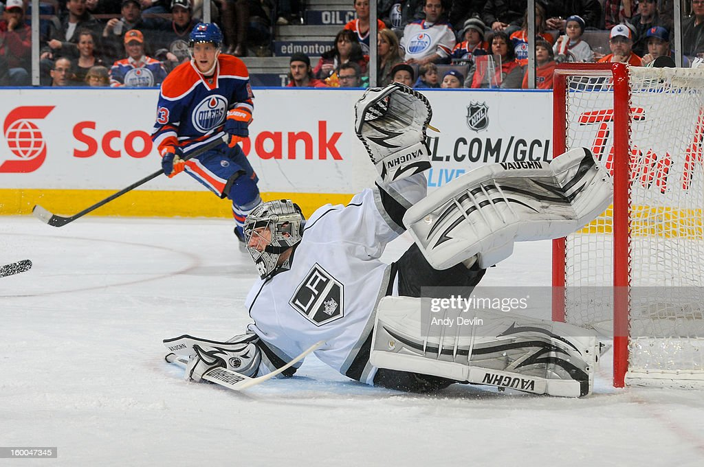 Jonathan Quick #32 of the Los Angeles Kings makes a sprawling save in a game against the Edmonton Oilers at Rexall Place on January 24, 2013 in Edmonton, Alberta, Canada.