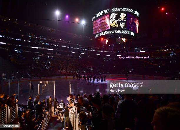 Jonathan Quick of the Los Angeles Kings makes his way to the ice during opening night of the Los Angeles Kings 20172018 season at Staples Center on...