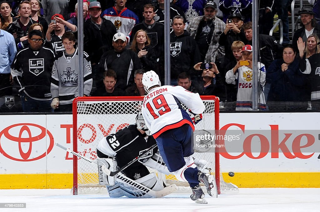<a gi-track='captionPersonalityLinkClicked' href=/galleries/search?phrase=Jonathan+Quick&family=editorial&specificpeople=2271852 ng-click='$event.stopPropagation()'>Jonathan Quick</a> #32 of the Los Angeles Kings makes the game winning save during the shootout against Nicklas Backstrom #19 of the Washington Capitals at Staples Center on March 20, 2014 in Los Angeles, California.