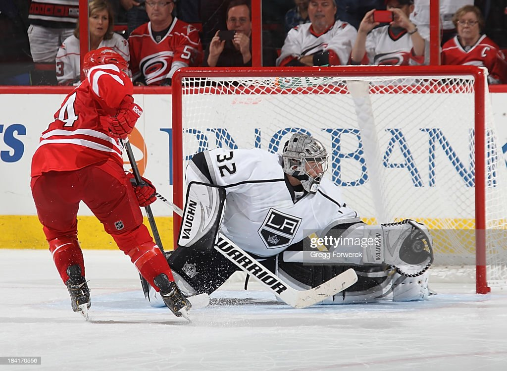 <a gi-track='captionPersonalityLinkClicked' href=/galleries/search?phrase=Jonathan+Quick&family=editorial&specificpeople=2271852 ng-click='$event.stopPropagation()'>Jonathan Quick</a> #32 of the Los Angeles Kings makes the game-winning save on a shot by <a gi-track='captionPersonalityLinkClicked' href=/galleries/search?phrase=Nathan+Gerbe&family=editorial&specificpeople=697084 ng-click='$event.stopPropagation()'>Nathan Gerbe</a> #14 of the Carolina Hurricanes in the shoot-out during an NHL game on October 11, 2013 at PNC Arena in Raleigh, North Carolina.
