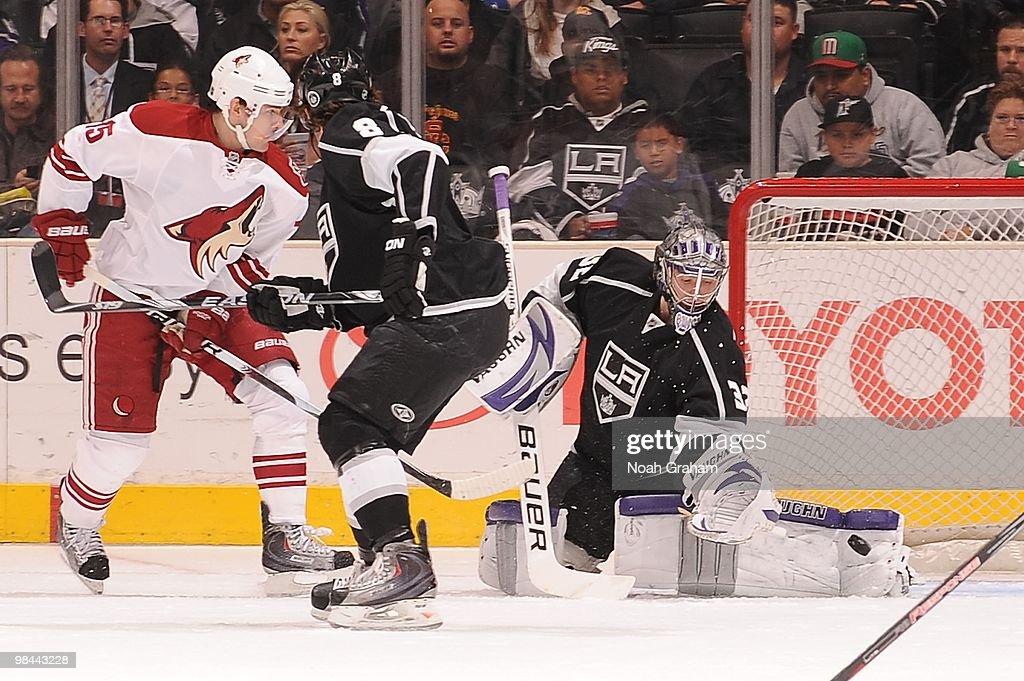 Jonathan Quick #32 of the Los Angeles Kings reaches to make the save while teammate Drew Doughty #8 plays defense against Matthew Lombardi #15 of the Phoenix Coyotes on April 8, 2010 at Staples Center in Los Angeles, California.