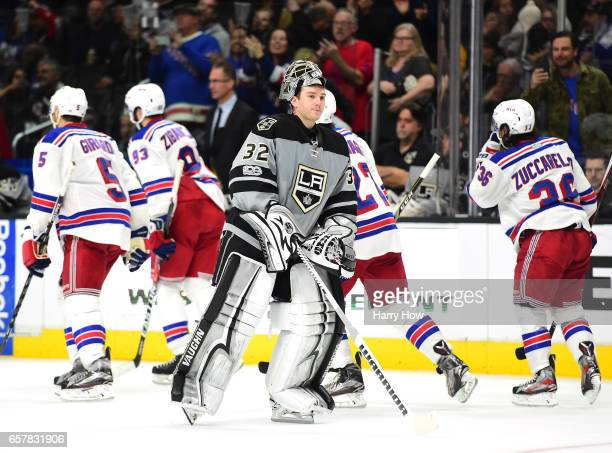 Jonathan Quick of the Los Angeles Kings reacts to an empty net goal by Rick Nash of the New York Rangers as he skates back to the net during the...
