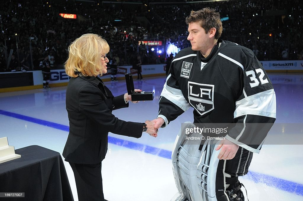 Jonathan Quick #32 of the Los Angeles Kings receives his 2011-2012 Championship Ring prior to the game against the Chicago Blackhawks at Staples Center on January 19, 2013 in Los Angeles, California.