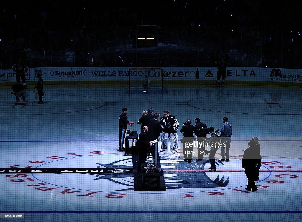 Jonathan Quick #32 of the Los Angeles Kings receives his Stanley Cup ring during a ceremony to begin the season before the game against the Chicago Blackhawks at Staples Center on January 19, 2013 in Los Angeles, California.