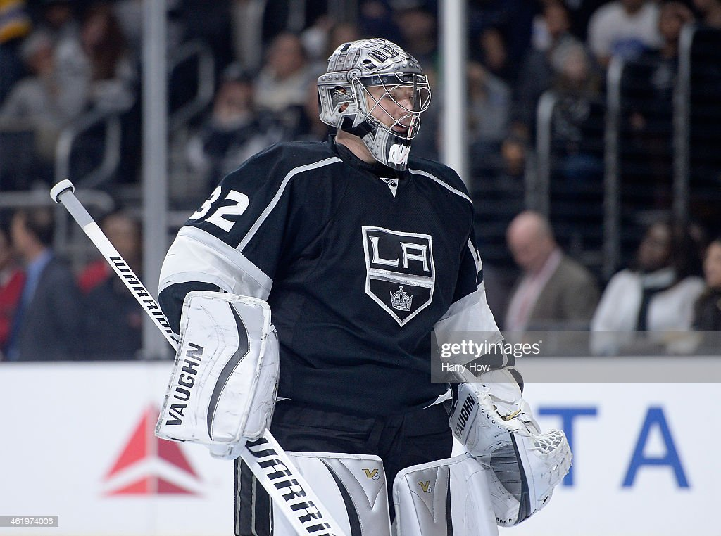 Jonathan Quick #32 of the Los Angeles Kings returns to the net during a stop in play against the Calgary Flames at Staples Center on January 19, 2015 in Los Angeles, California.