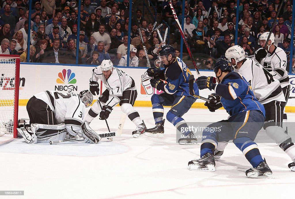 <a gi-track='captionPersonalityLinkClicked' href=/galleries/search?phrase=Jonathan+Quick&family=editorial&specificpeople=2271852 ng-click='$event.stopPropagation()'>Jonathan Quick</a> #32 of the Los Angeles Kings smothers the puck as <a gi-track='captionPersonalityLinkClicked' href=/galleries/search?phrase=Adam+Cracknell&family=editorial&specificpeople=2221797 ng-click='$event.stopPropagation()'>Adam Cracknell</a> #79 and <a gi-track='captionPersonalityLinkClicked' href=/galleries/search?phrase=Ryan+Reaves&family=editorial&specificpeople=4601052 ng-click='$event.stopPropagation()'>Ryan Reaves</a> #75 of the St. Louis Blues crash the net in Game Five of the Western Conference Quarterfinals during the 2013 NHL Stanley Cup Playoffs on May 8, 2013 at Scottrade Center in St. Louis, Missouri.