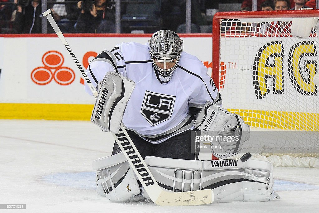 <a gi-track='captionPersonalityLinkClicked' href=/galleries/search?phrase=Jonathan+Quick&family=editorial&specificpeople=2271852 ng-click='$event.stopPropagation()'>Jonathan Quick</a> #32 of the Los Angeles Kings stops a shot from the Calgary Flames during an NHL game at Scotiabank Saddledome on April 9, 2014 in Calgary, Alberta, Canada. The Flames defeated the Kings 4-3 in shootout.