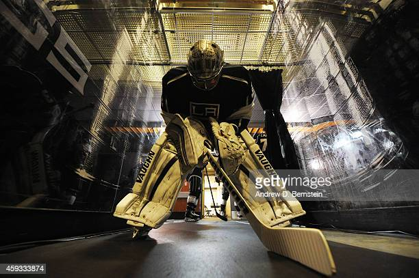 Jonathan Quick of the Los Angeles Kings stretches outside the locker room before a game against the Carolina Hurricanes at STAPLES Center on November...