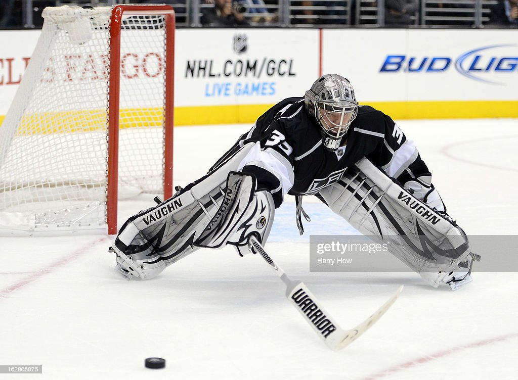 Jonathan Quick #32 of the Los Angeles Kings stretches to stop a shoot in during the game against the at Staples Center on February 25, 2013 in Los Angeles, California.
