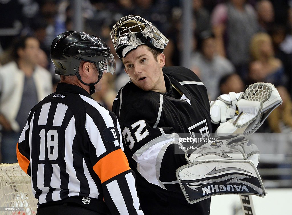 Jonathan Quick #32 of the Los Angeles Kings talks to referee Greg Kimmerly #18 during the third period of a 1-0 Kings win in Game Three of the Western Conference Quarterfinals during the 2013 NHL Stanley Cup Playoffs at Staples Center on May 4, 2013 in Los Angeles, California.