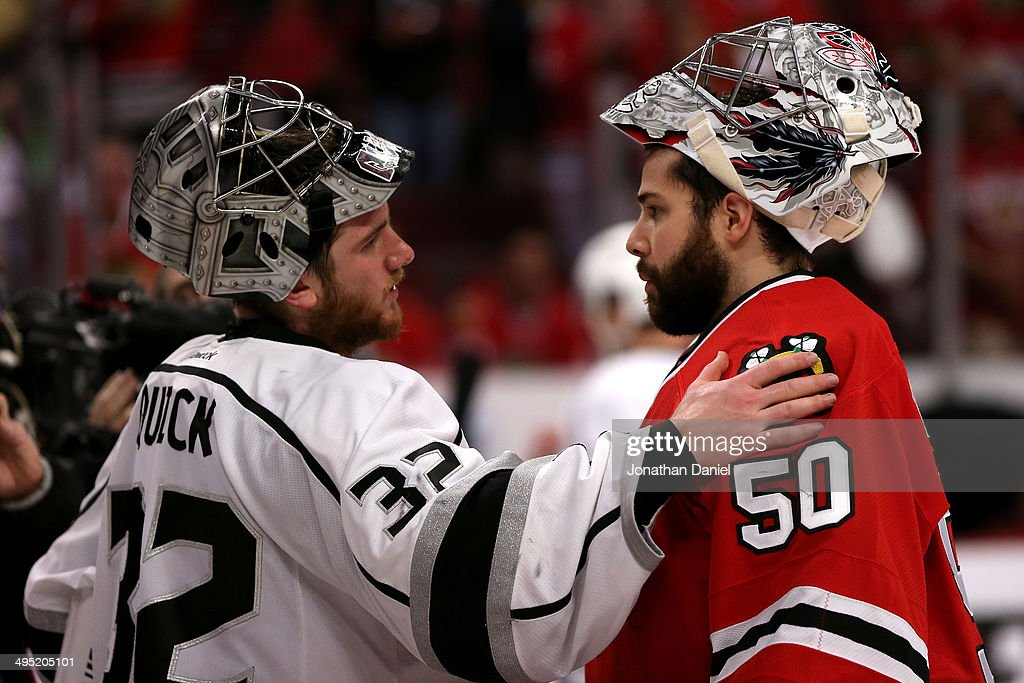 <a gi-track='captionPersonalityLinkClicked' href=/galleries/search?phrase=Jonathan+Quick&family=editorial&specificpeople=2271852 ng-click='$event.stopPropagation()'>Jonathan Quick</a> #32 of the Los Angeles Kings talks with <a gi-track='captionPersonalityLinkClicked' href=/galleries/search?phrase=Corey+Crawford&family=editorial&specificpeople=818935 ng-click='$event.stopPropagation()'>Corey Crawford</a> #50 of the Chicago Blackhawks after defeating the Blackhawks 5 to 4 in overtime of Game Seven to win the Western Conference Final in the 2014 Stanley Cup Playoffs at United Center on June 1, 2014 in Chicago, Illinois.