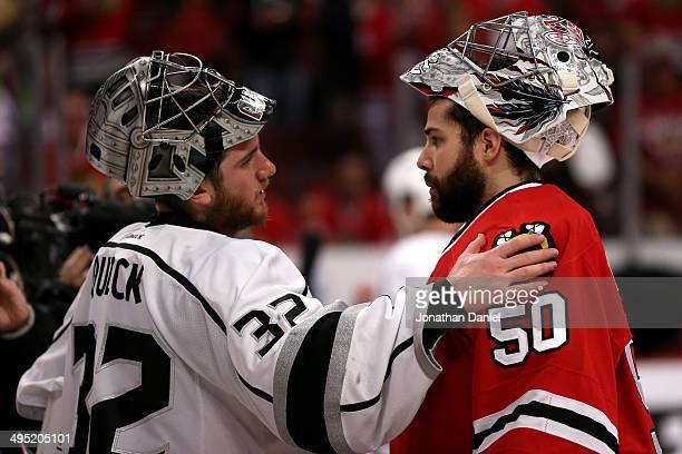Jonathan Quick of the Los Angeles Kings talks with Corey Crawford of the Chicago Blackhawks after defeating the Blackhawks 5 to 4 in overtime of Game...