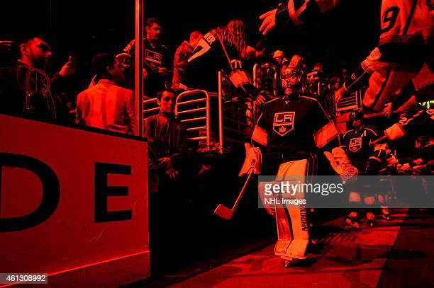Jonathan Quick of the Los Angeles Kings walks out to the ice for the beginning of the second period of play during a game against the Winnipeg Jets...