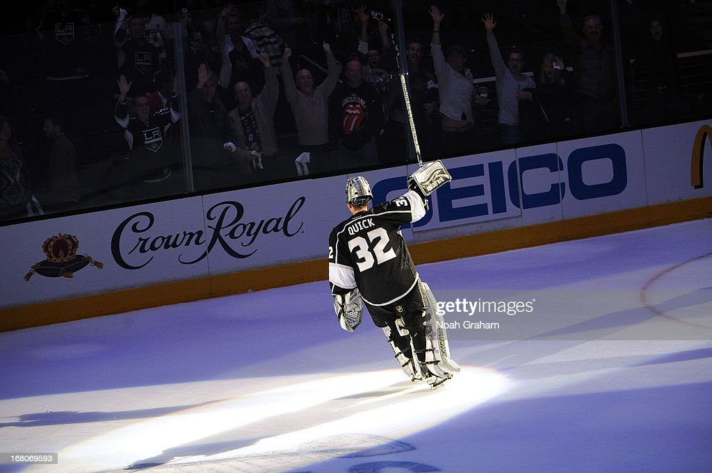 Jonathan Quick #32 of the Los Angeles Kings waves to the crowd after defeating the St. Louis Blues in Game Three of the Western Conference Quarterfinals during the 2013 NHL Stanley Cup Playoffs at Staples Center on May 4, 2013 in Los Angeles, California.