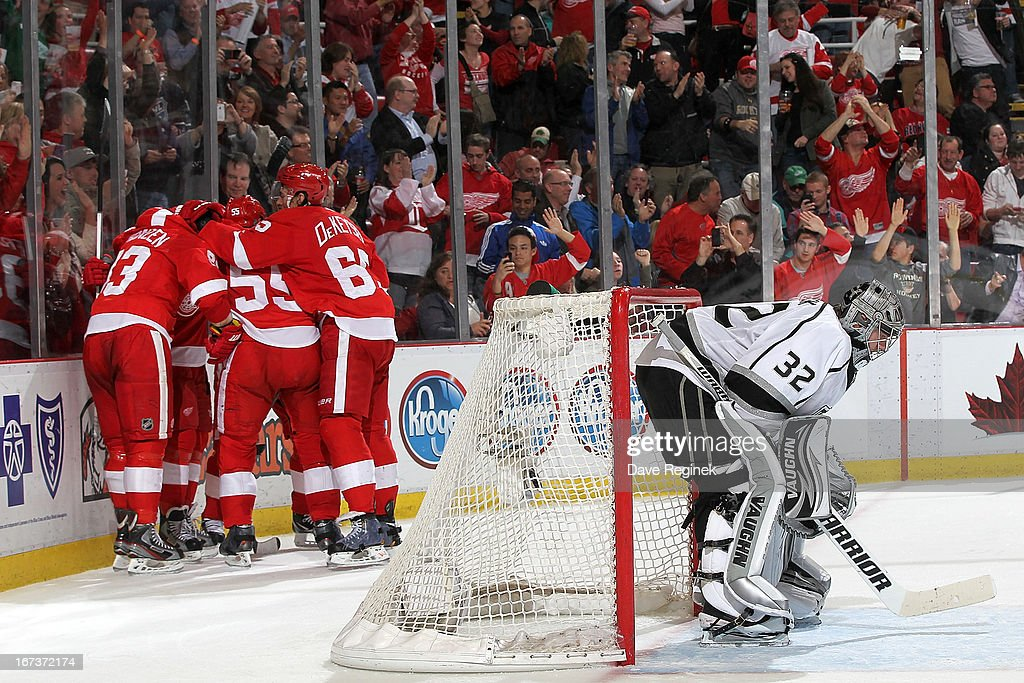 Jonathan Quick #32 of the Los Angeles looks down from the net as Niklas Kronwall #55, Danny Dekeyser #65, Henrik Zetterberg #40 and Pavel Datsyuk #13 of the Detroit Red Wings congratulate teamate Johan Franzen #93 after scoring a goal during a NHL game at Joe Louis Arena on April 24, 2013 in Detroit, Michigan. Detroit defeated Los Angeles 3-1
