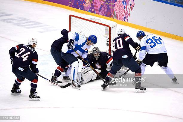 Jonathan Quick of the United States makes a save against Jori Lehtera and Jussi Jokinen of Finland in the first periodduring the Men's Ice Hockey...