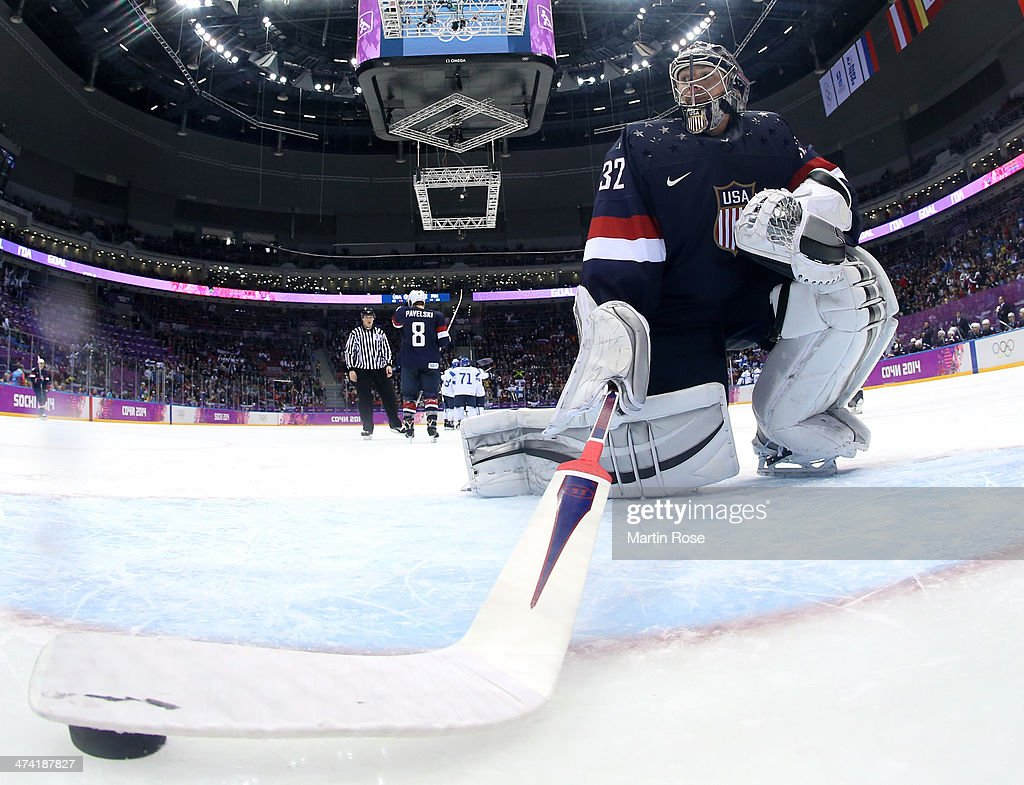 Jonathan Quick #32 of the United States retrieves the puck from the net after allowing a goal in the third period against Finland during the Men's Ice Hockey Bronze Medal Game on Day 15 of the 2014 Sochi Winter Olympics at Bolshoy Ice Dome on February 22, 2014 in Sochi, Russia.