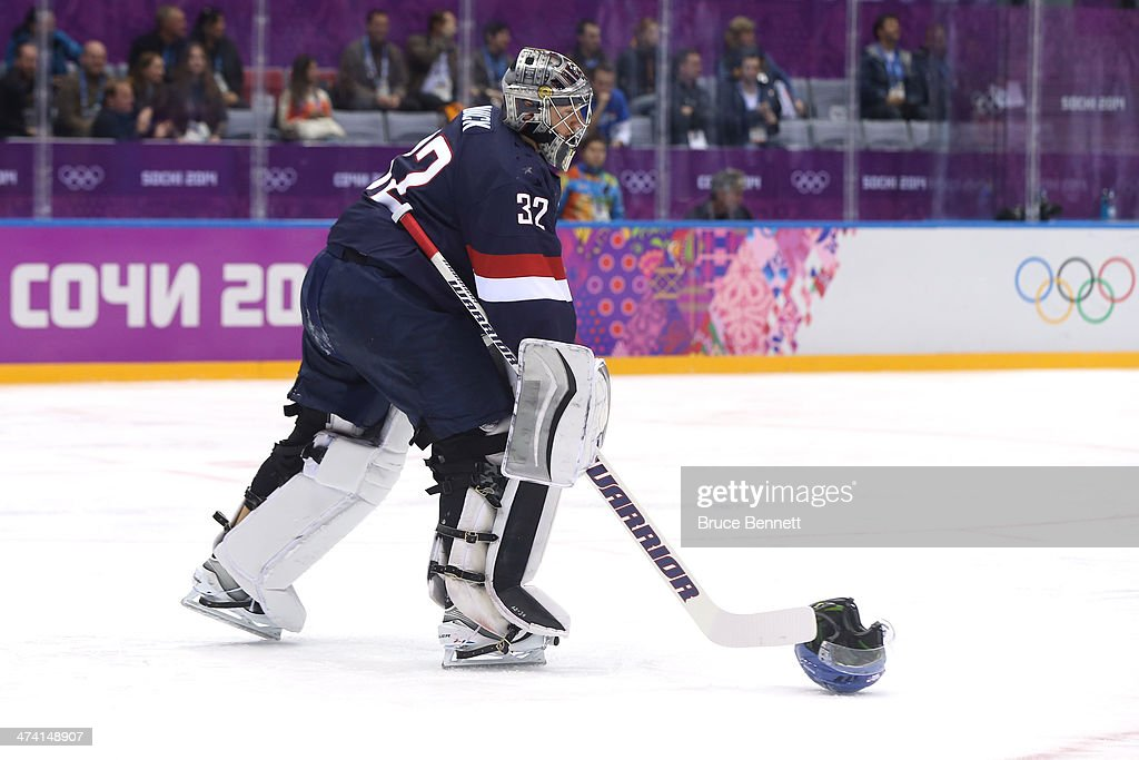 Jonathan Quick of the United States slides the helmet of Kimmo Timonen of Finland along the ice in the first period during the Men's Ice Hockey...