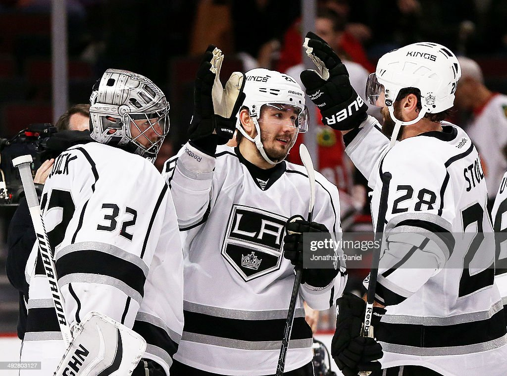 <a gi-track='captionPersonalityLinkClicked' href=/galleries/search?phrase=Jonathan+Quick&family=editorial&specificpeople=2271852 ng-click='$event.stopPropagation()'>Jonathan Quick</a> #32, <a gi-track='captionPersonalityLinkClicked' href=/galleries/search?phrase=Slava+Voynov&family=editorial&specificpeople=8315719 ng-click='$event.stopPropagation()'>Slava Voynov</a> #26 and <a gi-track='captionPersonalityLinkClicked' href=/galleries/search?phrase=Jarret+Stoll&family=editorial&specificpeople=204632 ng-click='$event.stopPropagation()'>Jarret Stoll</a> #28 of the Los Angeles Kings celebrate their 6 to 2 win over the Chicago Blackhawks in Game Two of the Western Conference Final during the 2014 Stanley Cup Playoffs at United Center on May 21, 2014 in Chicago, Illinois.