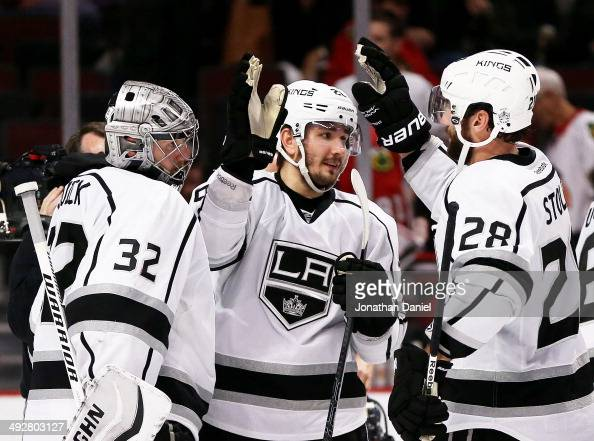 Jonathan Quick Slava Voynov and Jarret Stoll of the Los Angeles Kings celebrate their 6 to 2 win over the Chicago Blackhawks in Game Two of the...