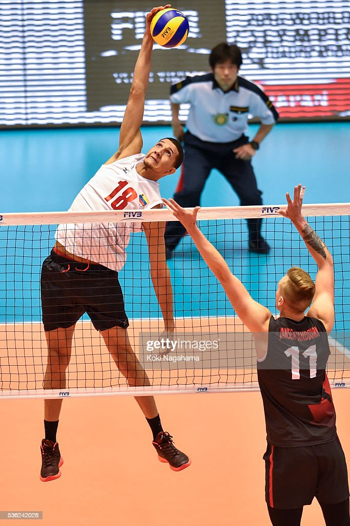 Jonathan Quijada #18 of Venezuela spikes the ball during the Men's World Olympic Qualification game between Venezuela and Canada at Tokyo Metropolitan Gymnasium on June 1, 2016 in Tokyo, Japan.