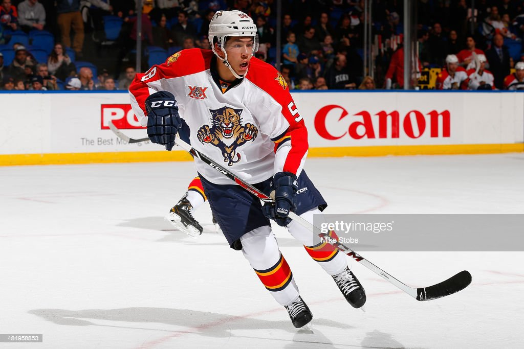 Jonathan Racine #58 of the Florida Panthers, playing in his first NHL game, skates against the New York Islanders at Nassau Veterans Memorial Coliseum on April 1, 2014 in Uniondale, New York. Islanders defeated the Panthers 4-2.