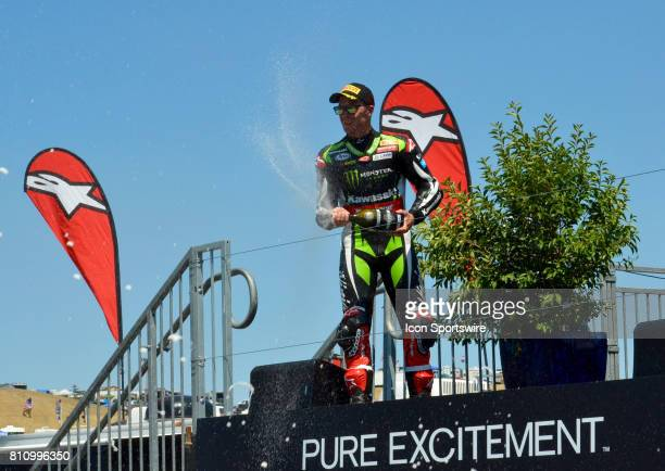 Jonathan Rea Kawasaki ZX10RR Kawasaki Racing Team sprays the crowd of fans after his second place finish in Race One at the SBK/MOTUL FIM Superbike...
