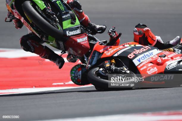 Jonathan Rea of Great Britain and KAWASAKI RACING TEAM and Chaz Davies of Great Britain and ARUBAIT RACINGDUCATI crashed out during the Superbike...