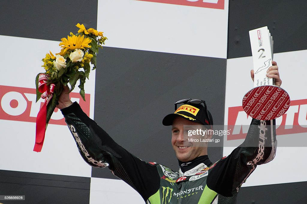 Jonathan Rea of Great Britain and KAWASAKI RACING TEAM celebrates the second place on the podium at the end of the Superbike race 2 during the World Superbikes - Race at Enzo & Dino Ferrari Circuit on May 10, 2015 in Imola, Italy.