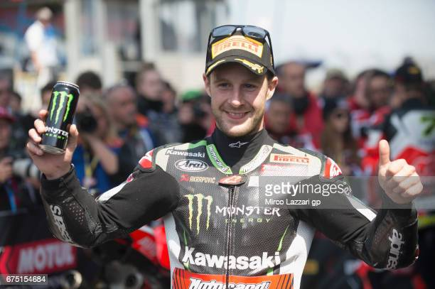 Jonathan Rea of Great Britain and KAWASAKI RACING TEAM celebrates the victory under the podium at th end of the race 2 during the FIM World Superbike...