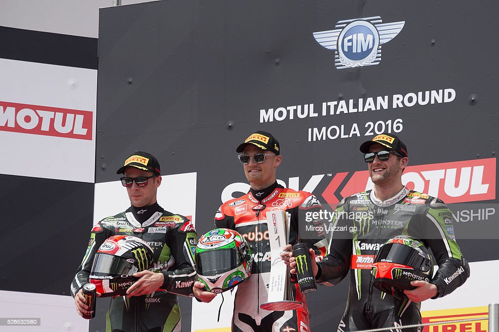 Jonathan Rea of Great Britain and KAWASAKI RACING TEAM, Chaz Davies of Great Britain and ARUBA.IT RACING-DUCATI and Tom Sykes of Great Britain and Kawasaki Racing Team celebrates on the podium at the end of the Superbike Race 1 during the World Superbikes - Qualifying at Enzo & Dino Ferrari Circuit on April 30, 2016 in Imola, Italy.