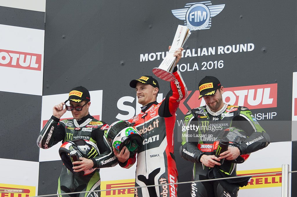 Jonathan Rea of Great Britain and KAWASAKI RACING TEAM, Chaz Davies of Great Britain and ARUBA.IT RACING-DUCATI and Tom Sykes of Great Britain and Kawasaki Racing Team celebrate on the podium at the end of the Superbike race 2 during the World Superbikes - Race at Enzo & Dino Ferrari Circuit on May 10, 2015 in Imola, Italy.