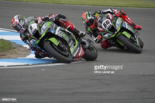 Jonathan Rea of Great Britain and KAWASAKI RACING TEAM leads Tom Sykes of Great Britain and Kawasaki Racing Team during the Race 1 during the FIM...