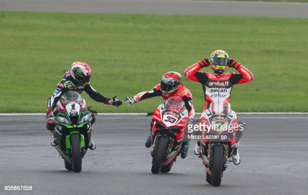 Jonathan Rea of Great Britain and KAWASAKI RACING TEAM Marco Melandri of Italy and ARUBAIT RACINGDUCATI and Chaz Davies of Great Britain and ARUBAIT...