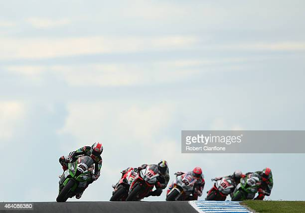 Jonathan Rea of Great Britain riding the Kawasaki Racing Team Kawasaki ZX10R leads at the start of race two of the World Superbikes World...