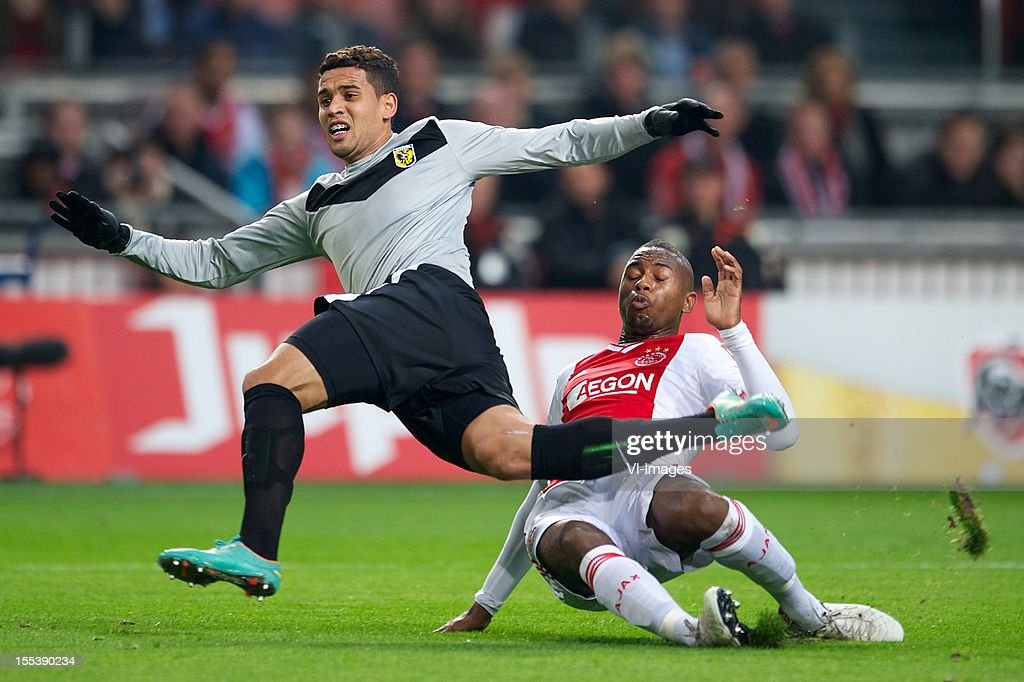 Jonathan Reis of Vitesse, Stefano Denswil of Ajax during the Dutch Eredivisie match between Ajax Amsterdam and Vitesse Arnhem at the Amsterdam Arena on November 3, 2012 in Amsterdam, The Netherlands.