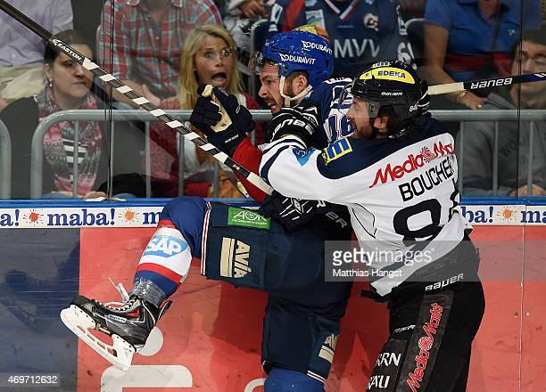 Jonathan Rheault of Mannheim is challenged by JeanFrancois Boucher of Ingolstadt during the DEL Playoffs Final Game 3 between Adler Mannheim and ERC...