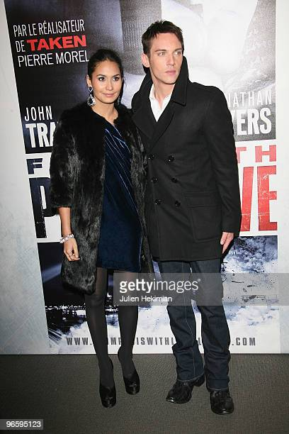 Jonathan RhysMeyers and his wife Reena Hammer attend 'From Paris with Love' Paris premiere at Cinema UGC Normandie on February 11 2010 in Paris France