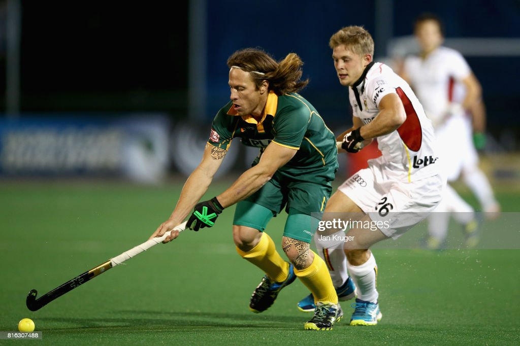 Jonathan Robinson of South Africa and Victor Wegnez of Belgium battle for possession during the Group B match between South Africa and Belgium on day five of the FIH Hockey World League - Men's Semi Finals on July 17, 2017 in Johannesburg, South Africa.