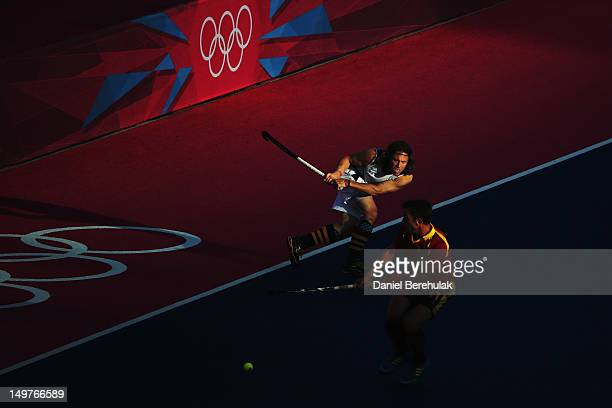 Jonathan Robinson of South Africa shoots past Xavi Lleonart of Spain during the Men's Hockey match between South Africa and Spain on Day 7 of the...