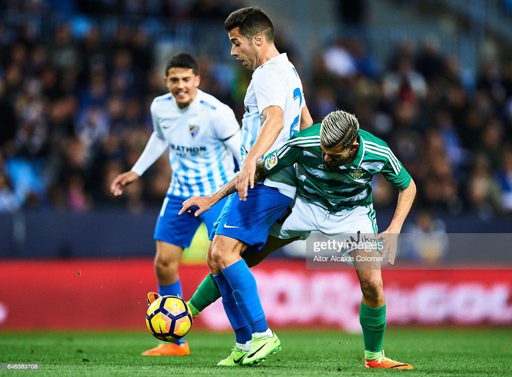 Jonathan Rodriguez of Malaga CF (L) competes for the ball with Dani Ceballos of Real Betis Balompie (R) during La Liga match between Malaga CF and Real Betis Balompie at La Rosaleda Stadium February 28, 2017 in Malaga, Spain.