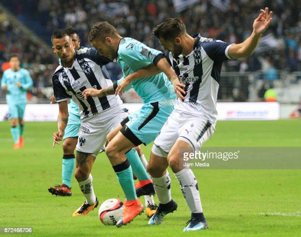 Jonathan Rodriguez of Santos fights for the ball with Leonel Vangioni and Nicolas Sanchez of Monterrey during the 11th round match between Monterrey...