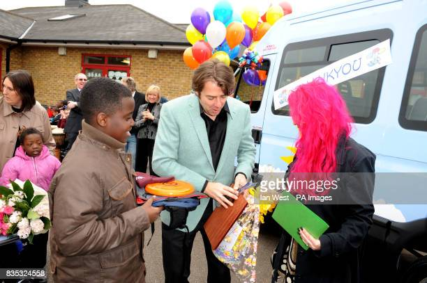 Jonathan Ross and his wife Jane present a Variety Club Sunshine Coach to the Trinity School in Dagenham Essex