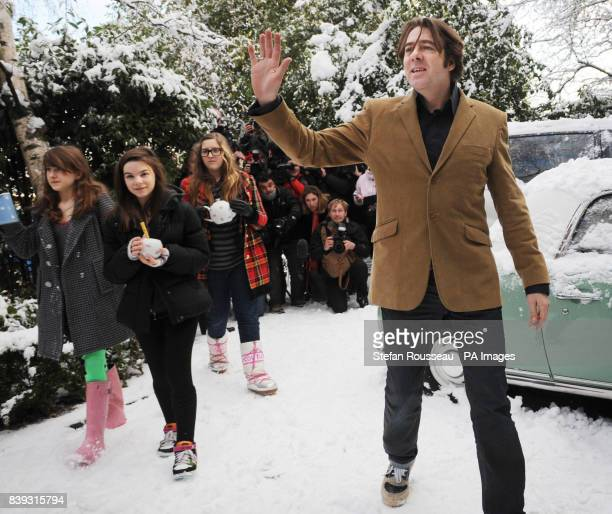 Jonathan Ross waves to the media outside his home in north London after he announced that he is to quit the BBC